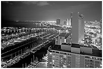 Ala Wai Yatch Harbor and skyline at night. Waikiki, Honolulu, Oahu island, Hawaii, USA (black and white)