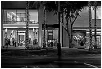 Shopping section of Kalakaua avenue at night. Waikiki, Honolulu, Oahu island, Hawaii, USA (black and white)