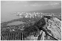 Tourist on Diamond Head crater summit observation platform. Oahu island, Hawaii, USA (black and white)