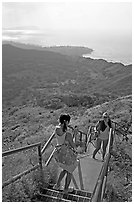 Tourists take a photo on the last steps of the Diamond Head crater summit trail. Oahu island, Hawaii, USA ( black and white)