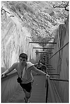 Tourist climbing a staircase on the Diamond Head summit trail. Oahu island, Hawaii, USA ( black and white)