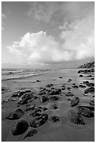 Boulders, coastline, and clouds, Lydgate Park, sunrise. Kauai island, Hawaii, USA ( black and white)