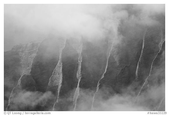 Fluted ridges seen through mist, Kalalau lookout, late afternoon. Kauai island, Hawaii, USA (black and white)