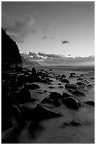 Boulders and misty surf from Kee Beach, dusk. Kauai island, Hawaii, USA ( black and white)