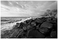 Boulders and coastline, Lydgate Park, sunrise. Kauai island, Hawaii, USA ( black and white)