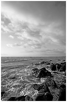 Boulders and ocean, Lydgate Park, sunrise. Kauai island, Hawaii, USA (black and white)