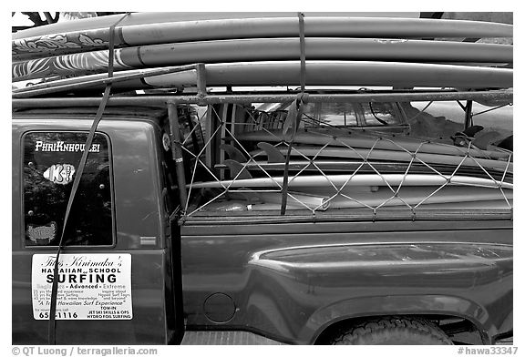 Pick-up truck loaded with surfboards, Hanalei. Kauai island, Hawaii, USA (black and white)