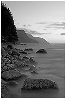 Boulders, surf, and Na Pali Coast, sunset. Kauai island, Hawaii, USA ( black and white)