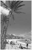Couple and tent, Sheraton Beach, mid-day. Kauai island, Hawaii, USA (black and white)