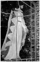 A stained glass with Jesus in traditional hawaiian robe, Palapala Hoomau church. Maui, Hawaii, USA ( black and white)