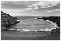 Couple on Papakolea green sand beach. Big Island, Hawaii, USA (black and white)