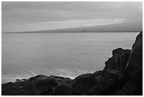 Lava rock shore and Mauna Loa shield profile from South Point. Big Island, Hawaii, USA (black and white)