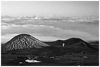 Antenna on volcano top above clouds. Mauna Kea, Big Island, Hawaii, USA (black and white)