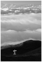 Astronomic radio antenna and sea of clouds. Mauna Kea, Big Island, Hawaii, USA (black and white)