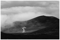 Radio telescope and clouds. Mauna Kea, Big Island, Hawaii, USA (black and white)