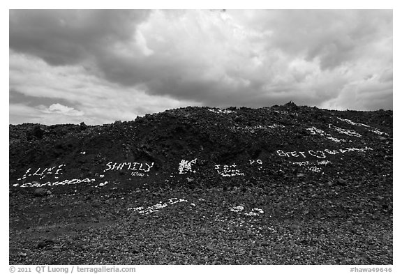Words made with light rocks against dark lava rocks. Big Island, Hawaii, USA (black and white)