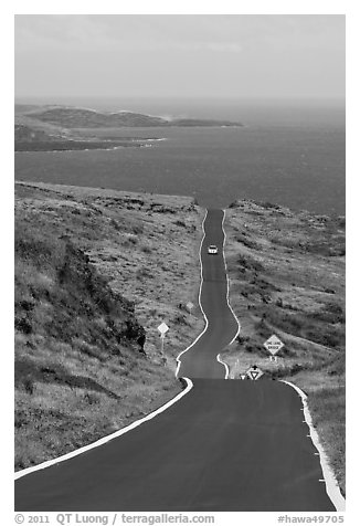One-lane road overlooking ocean. Maui, Hawaii, USA (black and white)