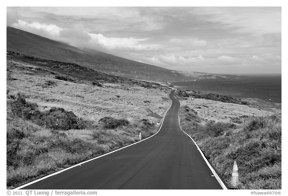 Road across arid landscape. Maui, Hawaii, USA (black and white)