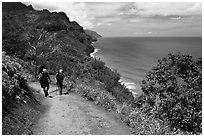 Hikers on Kalalau trail, Na Pali coast. Kauai island, Hawaii, USA ( black and white)