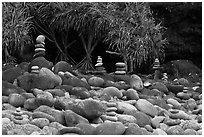 Rock piles on Hanakapiai Beach. Kauai island, Hawaii, USA ( black and white)