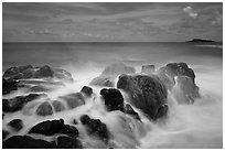 Rock with water motion and Mokuaeae island. Kauai island, Hawaii, USA (black and white)