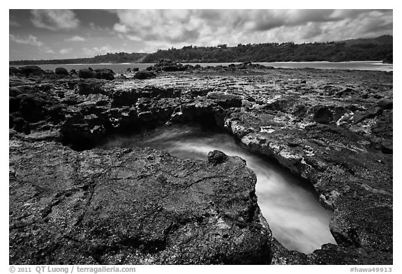 Blowhole,  Mokolea lava bench. Kauai island, Hawaii, USA (black and white)