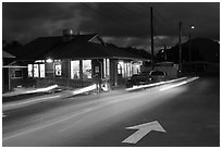 Restaurant and street by night, Lihue. Kauai island, Hawaii, USA ( black and white)
