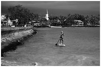 Paddlesurfer and Kailua-Kona. Hawaii, USA ( black and white)