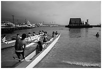 Kamakahonu Beach with outrigger canoeists, Kailua-Kona. Hawaii, USA (black and white)