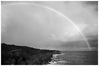 Rainbow over volcanic costline. Big Island, Hawaii, USA (black and white)