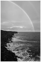 Volcanic coastline and double rainbow. Big Island, Hawaii, USA (black and white)