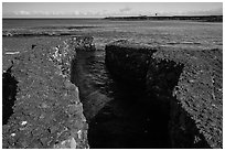 Walled stream flowing into Kiholo Bay. Big Island, Hawaii, USA ( black and white)