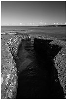 Walled stream and Kiholo Bay. Big Island, Hawaii, USA (black and white)