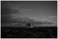 Lone house on the lava field at night, Kalapana. Big Island, Hawaii, USA ( black and white)