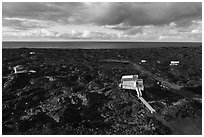 Aerial view of houses on new lava field, Kalapana. Big Island, Hawaii, USA ( black and white)