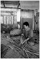 Woman weaving a toga (mat) out of pandamus leaves. American Samoa ( black and white)