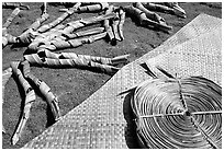 Pandanus leaves and a finished toga (mat) made out of it. American Samoa ( black and white)