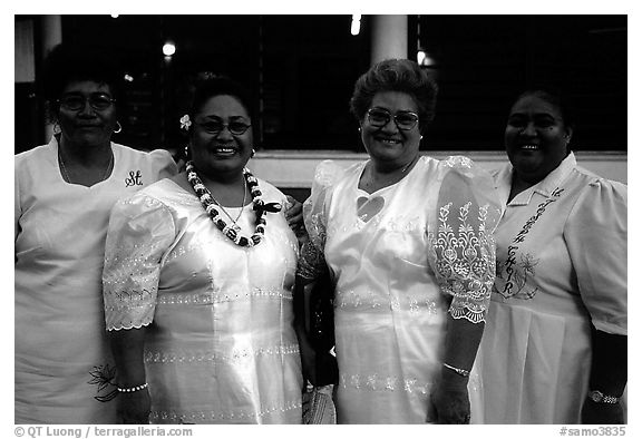 Sunday women churchgoers dressed in white, Pago Pago. Pago Pago, Tutuila, American Samoa (black and white)