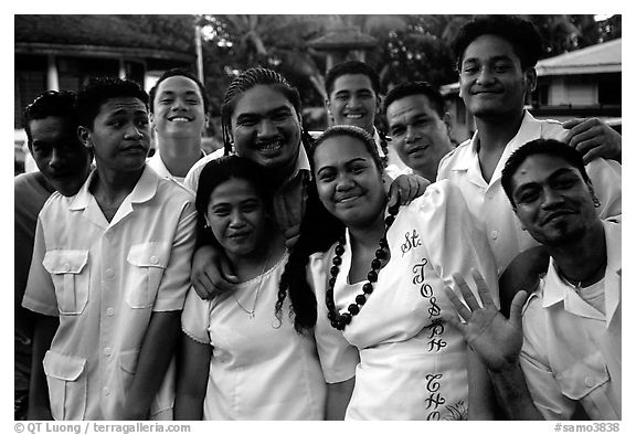 Group of Sunday churchgoers, all white-clad, Pago Pago. Pago Pago, Tutuila, American Samoa (black and white)