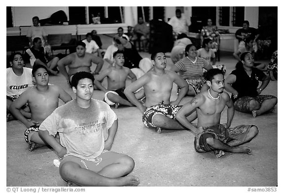 Villagers getting ready for traditional dance, Aua. Tutuila, American Samoa (black and white)