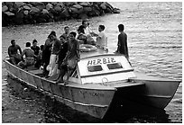 Villagers crowd a ferry to Aunuu. Aunuu Island, American Samoa ( black and white)