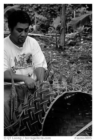 Villager weaving a basket out of a single palm leaf. Tutuila, American Samoa (black and white)