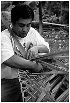 Villager weaving a basket out of a single palm leaf. Tutuila, American Samoa ( black and white)