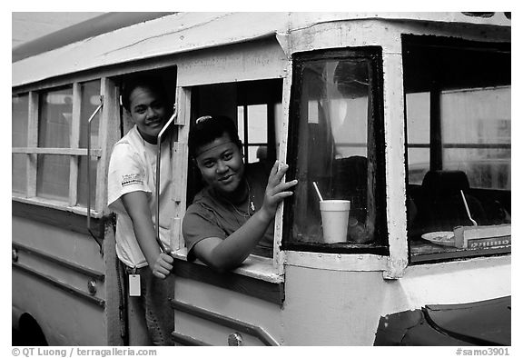 Women in a colorful bus. Pago Pago, Tutuila, American Samoa (black and white)