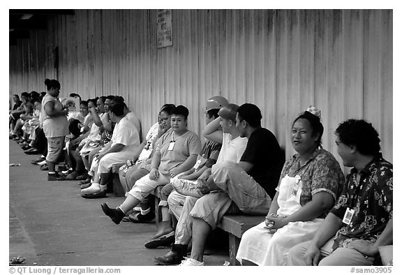 Workers of the tuna factory during a break. Pago Pago, Tutuila, American Samoa (black and white)