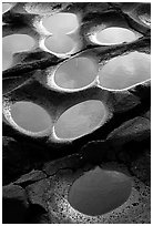 Ancient grinding stones holes (foaga) near Leone. Tutuila, American Samoa (black and white)