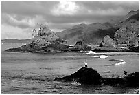 Fishermen on the rocky shore near Maa Kamela. Tutuila, American Samoa (black and white)