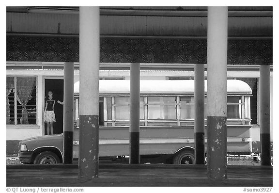 Bus and fale in Masefau village. Tutuila, American Samoa (black and white)