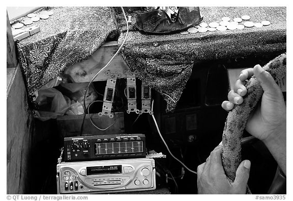 Hands of Aiga bus driver and sound system. Pago Pago, Tutuila, American Samoa (black and white)