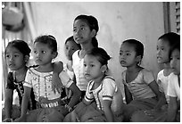 Girls learn traditional singing at  Apsara Arts  school. Phnom Penh, Cambodia ( black and white)